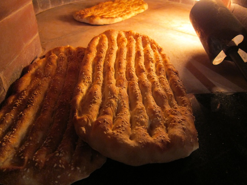 Barbari bread in the process of baking inside the oven