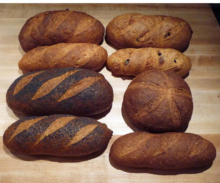 Here Are Four Types Of Bread That Were Cooked In The Oven At Same Temperature Time Top Left Rustic White Right Kalamata